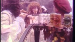 Nell Gwynn and her oranges in a Tango ad.  Archive film 93034