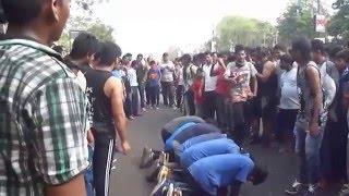 A boy jumping over 6 boys in a line in Bhubaneswar Raahgiri Day
