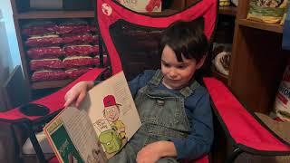 Tobias reading Dave Ramsey's The Big Birthday Surprise