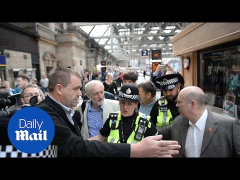 Jeremy Corbyn arrives at Glasgow Central on a Virgin Train - Daily Mail