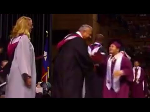 Graduate with Down syndrome jumps across stage in excitement