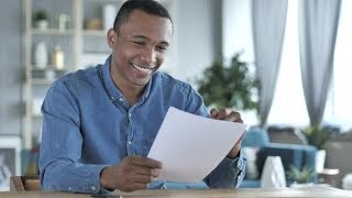 Young African Man Excited after Reading Documents | Stock Footage - Videohive