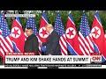 Trump and Kim Jong Un shake hands at Singapore summit