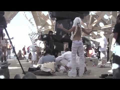 The action of healing in Temple of Whollyness, at Burning Man, 2013.
