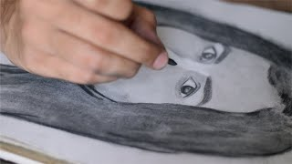 Close up shot of an artist sketching on paper