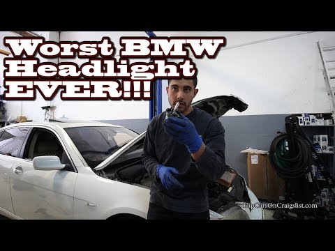 Mechanics fight Headlight on a BMW SHOP VLOG