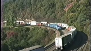 3 Conrail trains pass as they battle famous Horseshoe Curve. 10/10/1989