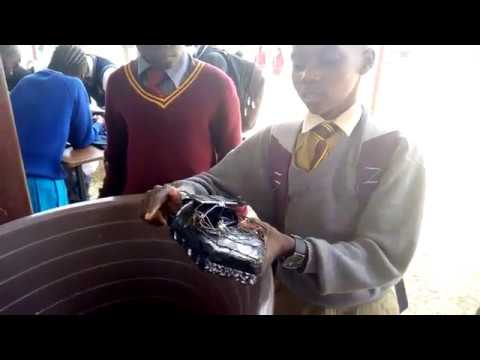 Chipindura Primary Student Show Cases His Solar Powered Boat