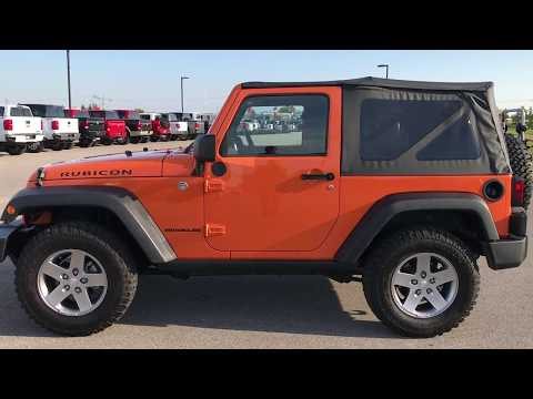 SOLD! 9226 USED 2012 JEEP WRANGLER RUBICON ORANGE CRUSH WISCONSIN 6 SPEED $28,999 www.SUMMITAUTO.com