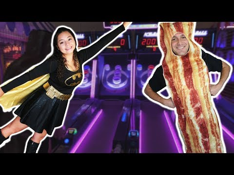 Batgirl and Mr. Bacon at the Arcade for Halloween!
