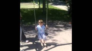 Singing Swing!! (small Child On Musically Swinging Swing)