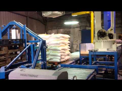 Automated system to handle and stack sacks of flour