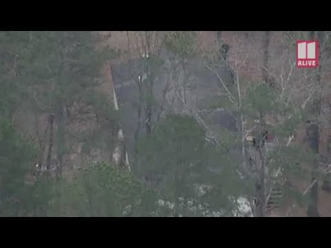 SWAT members send tear gas into Gilmer County home during standoff   D
