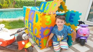 Ali built ABC Playhouse near house and new toys