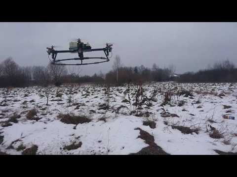 Gasoline powered quadrocopter. MMS Drone flight at bad weather conditions.