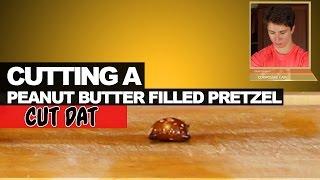 Cutting A Peanut Butter Filled Pretzel Nugget