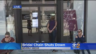 Women Camp Out At Closed Doors Of Closed Bridal Shop