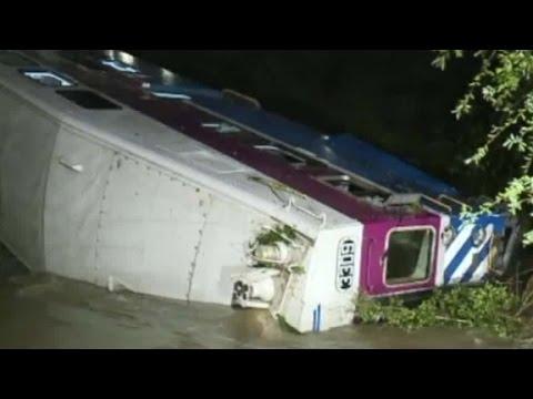 Train car derails, falls into creek