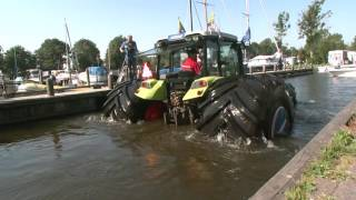 Mitas tyres helped 4-tones tractor float like a boat in deep water.