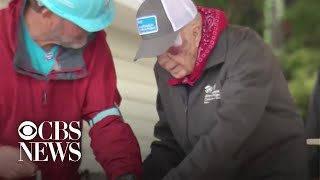 A day after falling, former President Jimmy Carter joins a Habitat for Humanity event