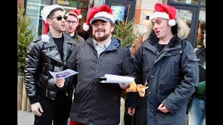 Jack Black & Nick Jonas go carol singing!