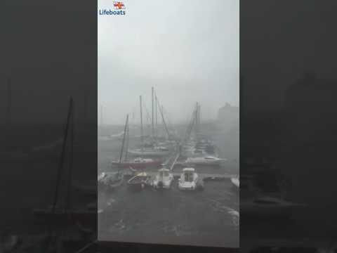 Bad Achub Aberystwyth Lifeboat volunteer films 94 mph winds blowing through Aberystwyth harbour