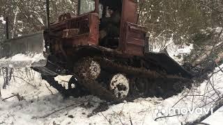 ТдТ-55 в лесу в грязи.