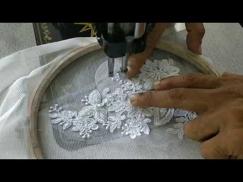 Aplic work for a Christian wedding gown