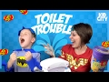 Toilet Trouble Game with Funny Bean Boozled Challenge ft BATMAN & WONDER WOMAN   KIDCITY