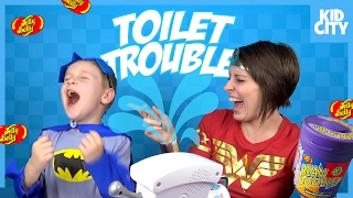Toilet Trouble Game with Funny Bean Boozled Challenge ft BATMAN & WONDER WOMAN | KIDCITY