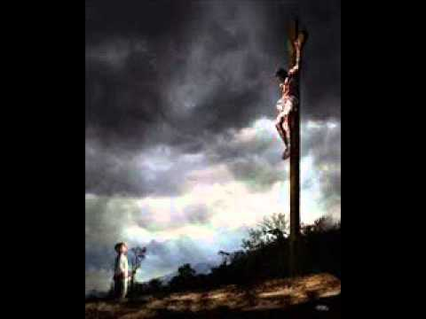 Din cer Iisus veni sa moara pe cruce rastignit