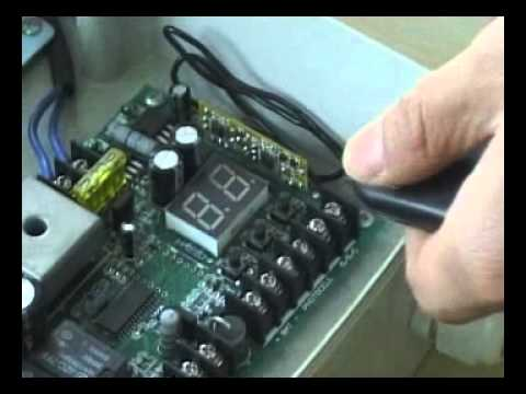 How to program remote control transmitter for ALEKO AS600