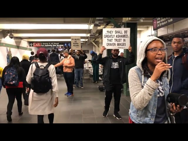 Christian woman overwhelmed by Holy Spirit preaches in NYC subway