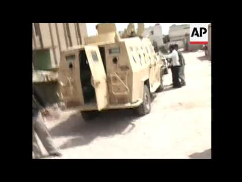 Mahdi army in control of Iraqi military HQ, military vehicle set on fire