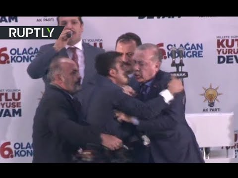 Erdo-hug: Fan rushes on stage to embrace Turkish president