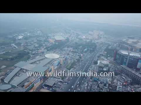 The Great India Place mall : Aerial view of buzzing NOIDA commerce and traffic