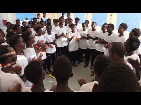 Eritrean migrants celebrate their rescue in the Mediterranean