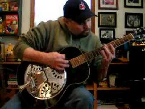 Playing An Acoustic Fender Resonator Guitar And Glass Slide