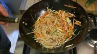 Stir frying rice noodles