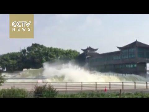 Watch: Huge waves pour into downtown Hangzhou from Qiantang River
