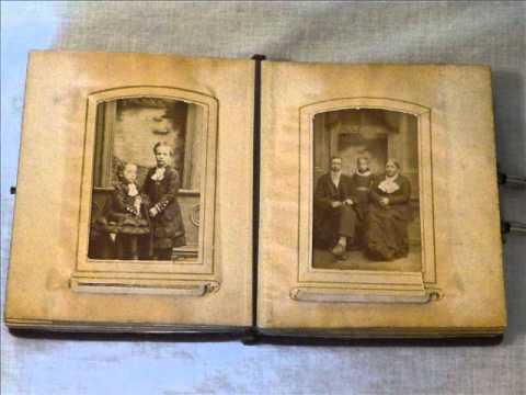 Tintypes, CDV's & Early photos in a Velvet-bound album.wmv