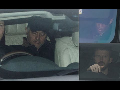 Manchester United arrive for training in gloomy weather