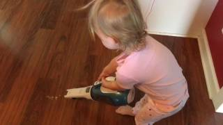 Lydia uses the Dustbuster