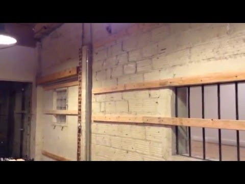 Insulated floating walls for sound and temperature control in brick and concrete buildings