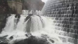 AMAZING DRONE VIDEO Flying straight up and out of Dam falls