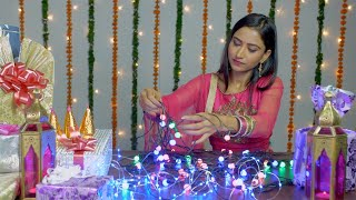 Beautiful Indian girl arranging the Diwali lights to decorate her home - Indian festival