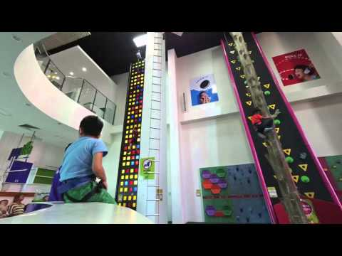 ladder climb (without using legs) at Kids City in Phnom Penh, Cambodia