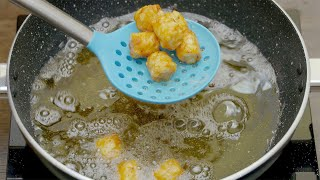 Close top shot of deep frying potato bites in oil