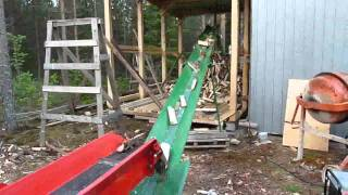 Splitting firewood straight into a shed, Part 2.