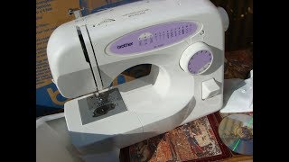 BROTHER  SEWING MACHINE MODEL XL2230  & PEDAL & ACCESSORIES  SEE  VEDIO